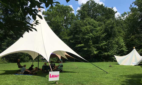 Event tents in field for Compassion Camp sessions on non-violent communication