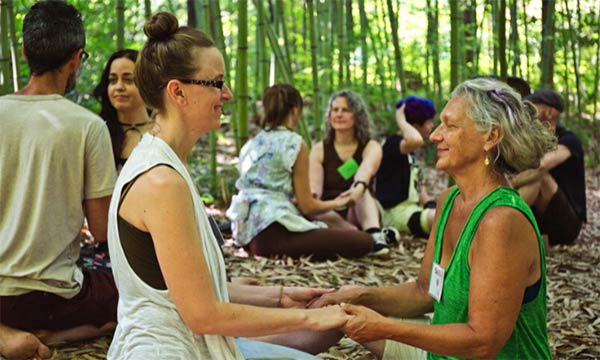 Partner communication exercises in the forest at Earthaven Ecovillage