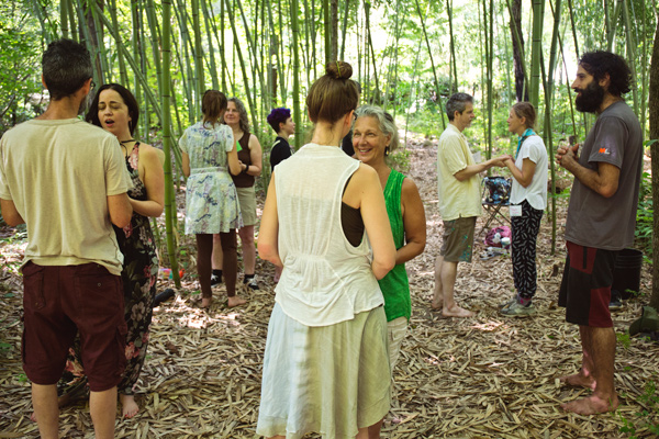 SOIL class participants doing connection ritual in the bamboo forest