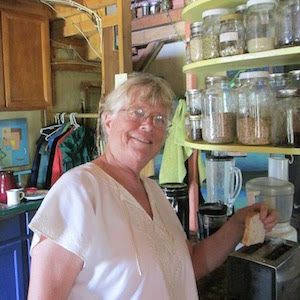 Suchi in her homestead kitchen at Earthaven Ecovillage