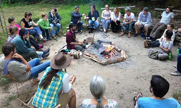 Permaculture expert Zev Friedman leading a fire circle at a Permaculture Design Certificate course