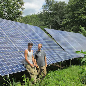 Off-grid power experts Brandon and Chris Farmer with the Hut Hamlet micro-grid solar panels