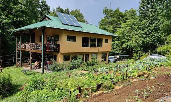 Green-built house with gardens and solar hot water